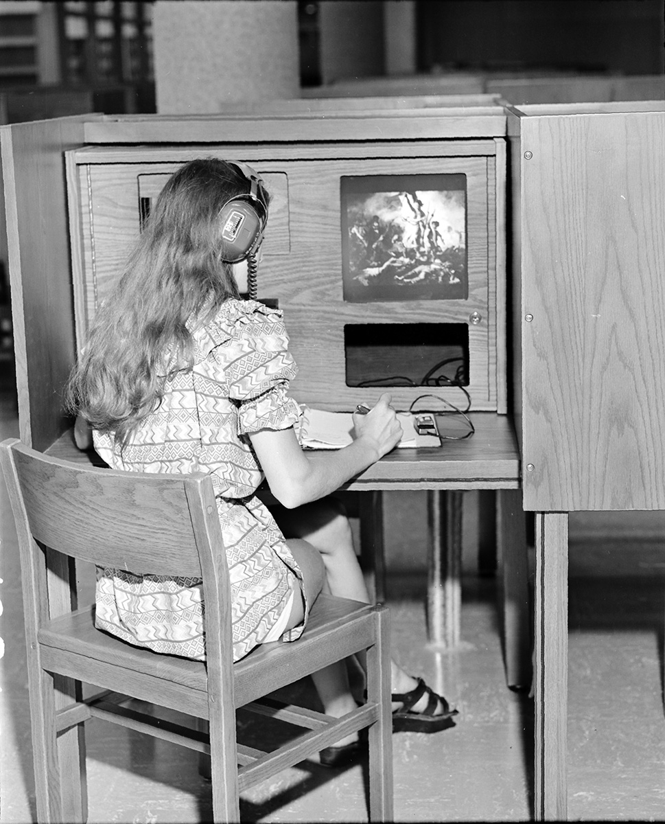 Students from Eau Claire's IS department go on to work for companies such as 3M, Kohl's and Mayo Clinic Health Systems. Pictured is a student using a computer on campus in 1973.