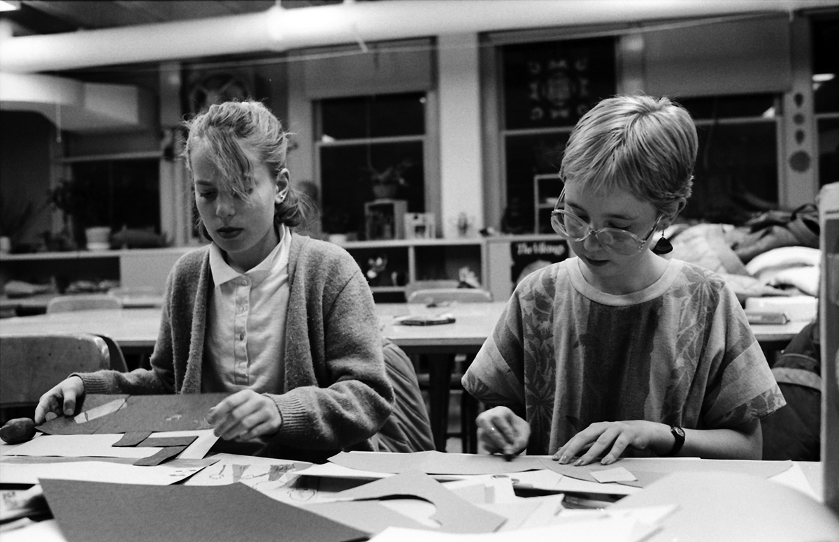 Students in the Special Education program work with children prior to graduation. Shown are students from the School of Education creating art projects in 1986.
