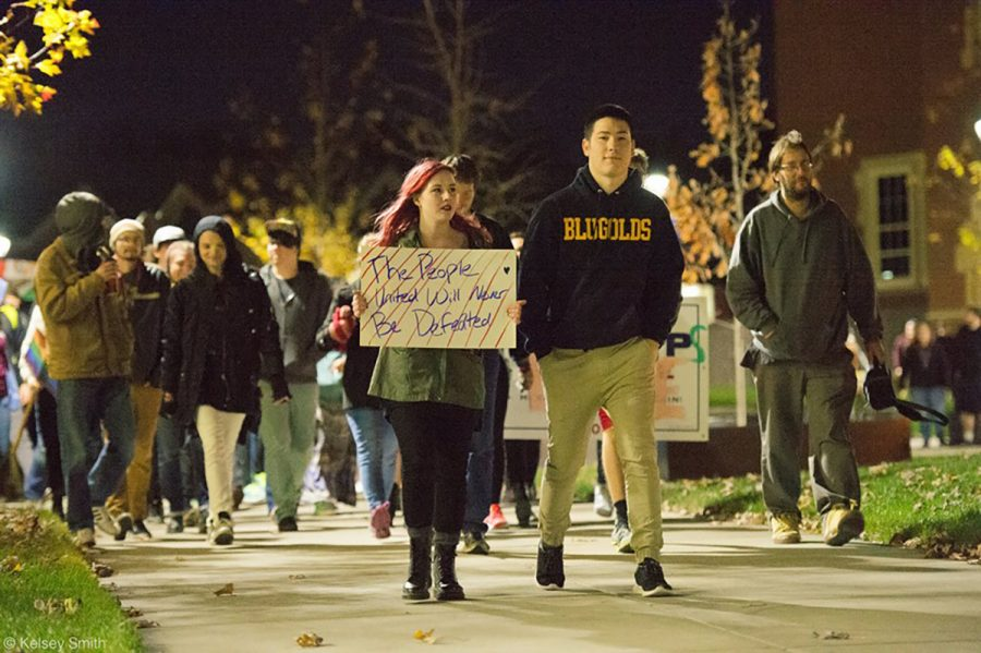 UW-Eau Claire students Aubrie Peterson and Robert Nguyen organized the anti-Trump march Thursday night after the election. Together the two spoke to demonstrators before  their march downtown.