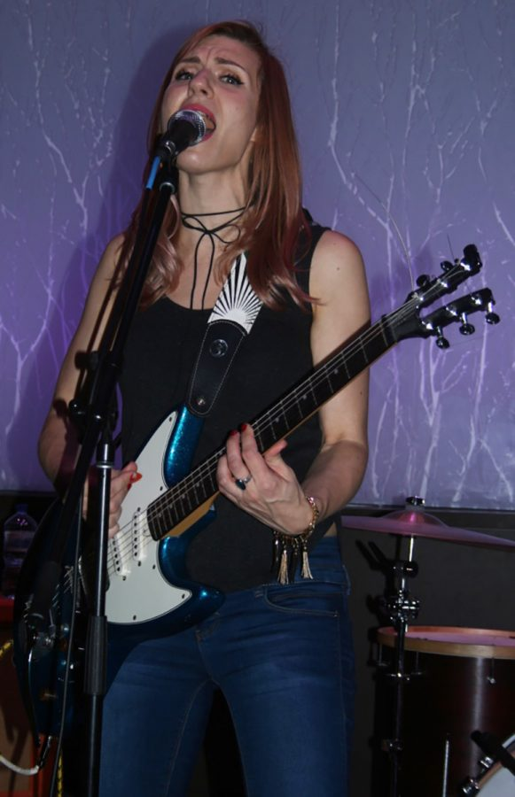 Priscilla Priebe, a third of the band Maudlin, brought liveliness and zest to The Cabin.