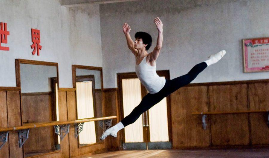 """Li Cunxin dances in one of the ballet academy's practice rooms in """"Mao's Last Dancer."""""""