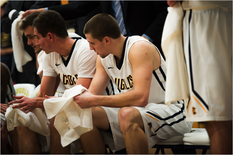 Blugold men's basketball player Josh Weix, takes a breather at half-time.
