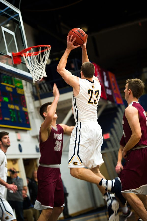 Freshman+Josh+Weix+aims+and+shoots+during+a+game+against+Viterbo+University.+