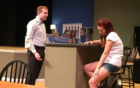 "UW-Eau Claire's theatre production of ""Rabbit Hole"" depicts fifth year senior theatre arts student Cory McMenomy as Howie and senior advertising student Sidney Fairbrother as Izzy, who are arguing about the best way to deal with their tragic situation."