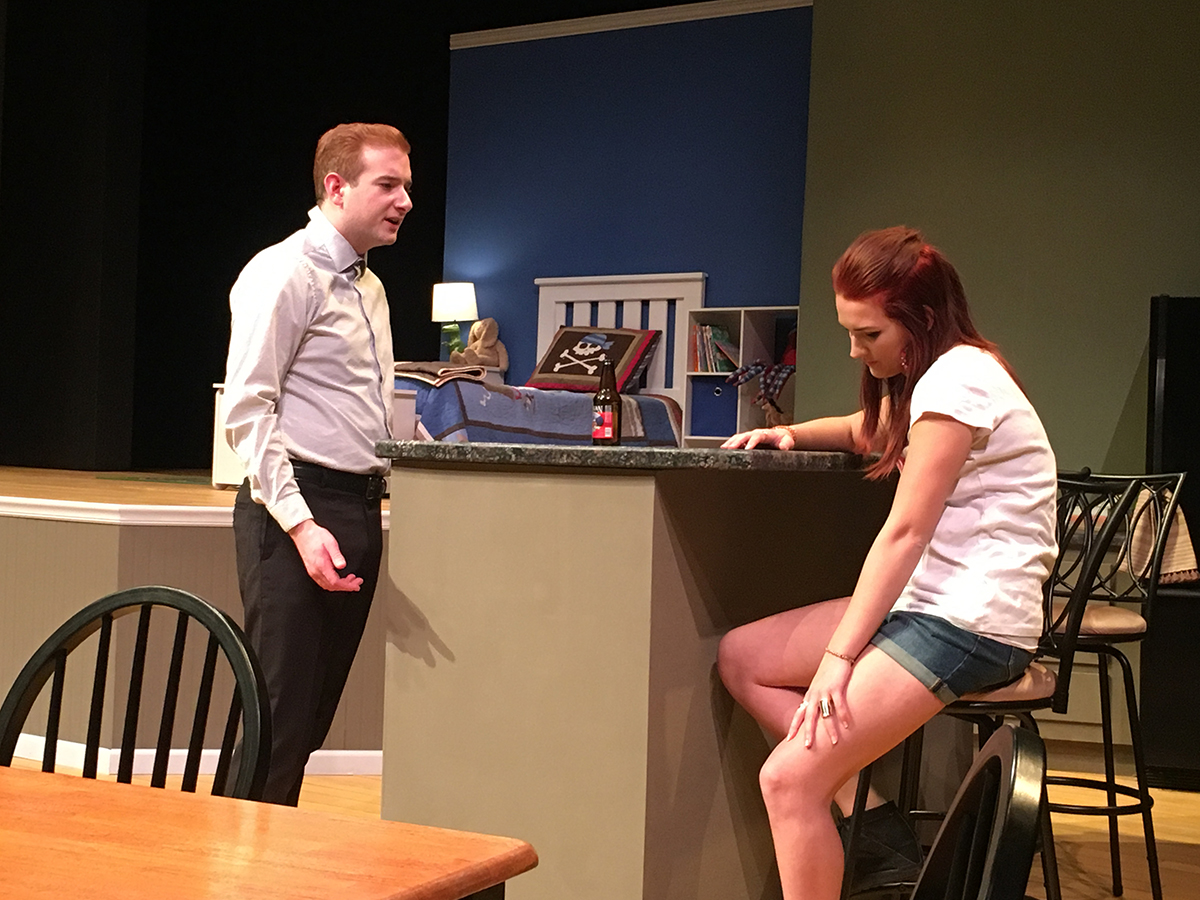 """UW-Eau Claire's theatre production of """"Rabbit Hole"""" depicts fifth year senior theatre arts student Cory McMenomy as Howie and senior advertising student Sidney Fairbrother as Izzy, who are arguing about the best way to deal with their tragic situation."""
