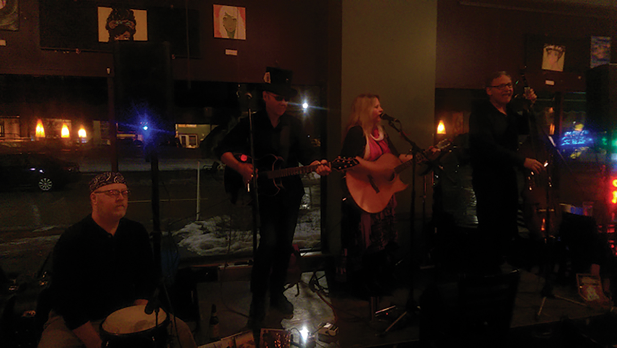 Acoustic-based group, Wolfsong, will be releasing an album later in spring and performed at Acoustic Cafe on Friday night. Instruments featured are the upright bass, acoustic guitar, conga and a cajun.