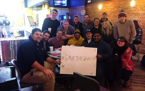 UW-Eau Claire students rallied around Mike's Cheese Shack last Friday night, holding a sign that eventually received around 100 signatures.