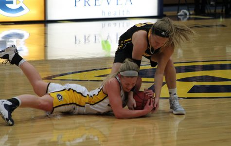 Eau Claire's Arien Brennan and Oshkosh's Morgan Kokta struggle over possession of the ball.