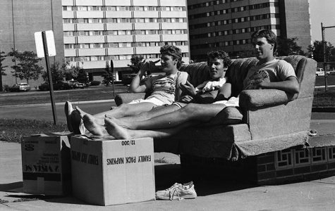 These UW-Eau Claire students are pictured in 1980, relaxing in between their move into the residence halls on upper campus.