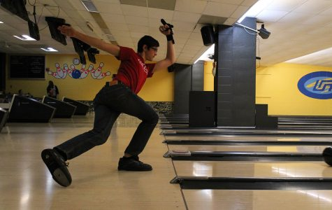 League member Joe Woznicki sliding on the approach at the Bowling and Billiard Center