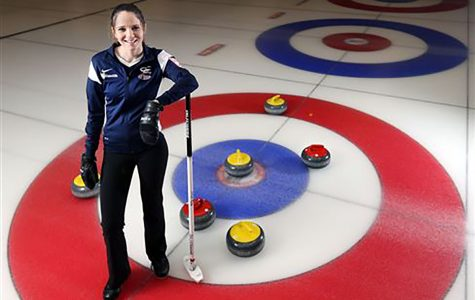 Jenna Burchesky curls at the Eau Claire Curling Club on Monday nights.