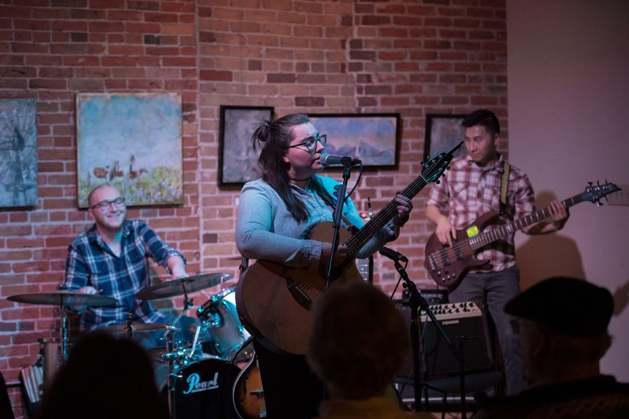 Local musician Caitlin McGarvey along with bassist, Alex Vang, and drummer, Ben Peterson, performed their first set on stage together opening for Bri Murphy Saturday night at Volume One. McGarvey said she hopes to release her EP in March 2017, featuring instrumental backup from both Vang and Peterson.