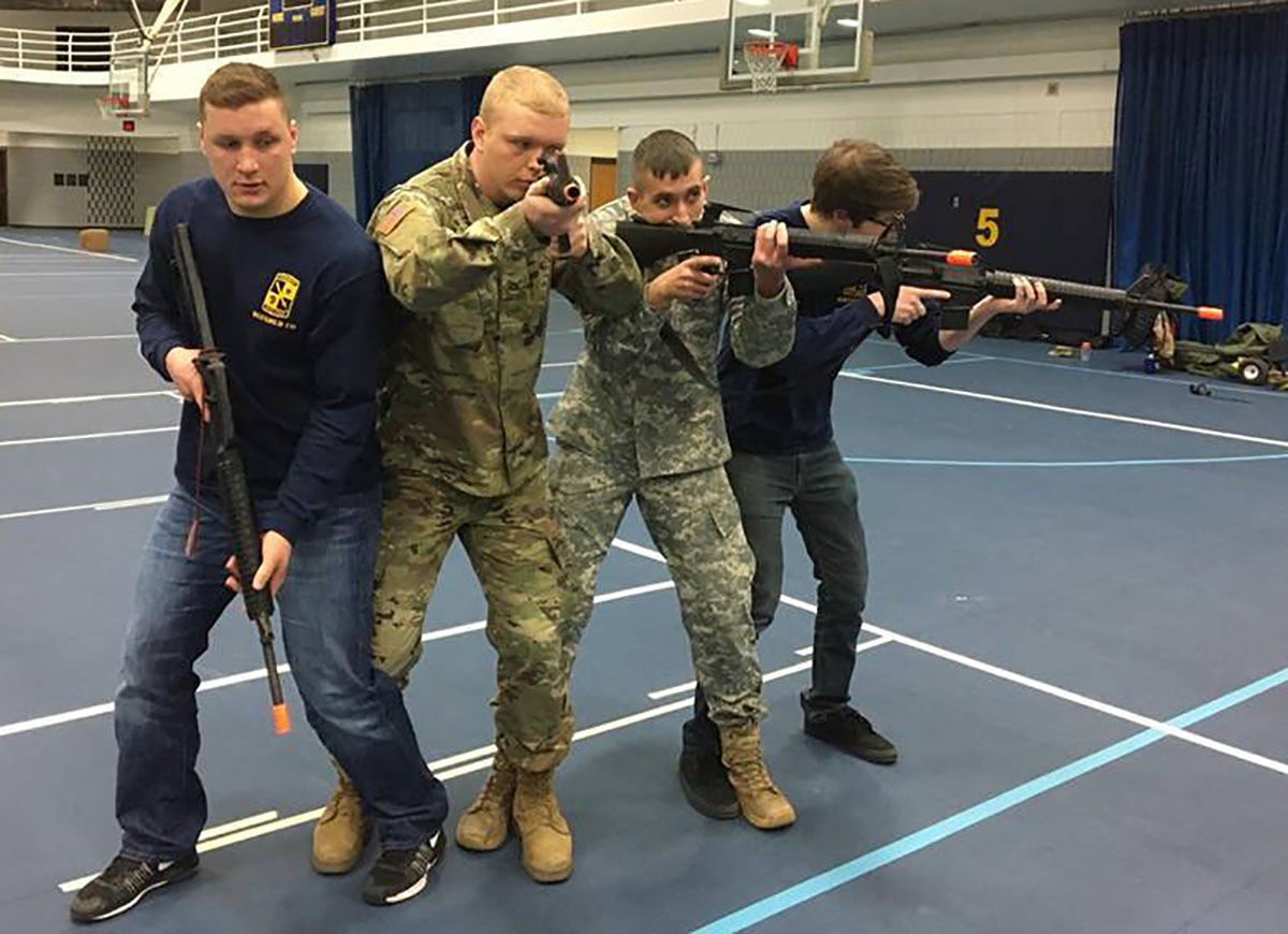 Alexander Miller (far right) and three other cadets in the ROTC program, Ben Venner (far left), Josiah Wahl (left) and Taylor Steffen (right), got a chance to participate in a simulated military mission as part of their Military Science and Leadership 202 class.