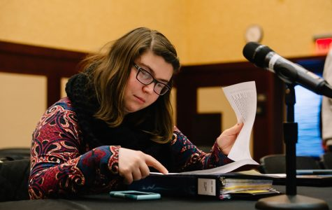 Of-Campus Senator Bobbi Freagon, pictured, reviews the College Republicans special funds allocation bill during Monday's Student Senate Session.