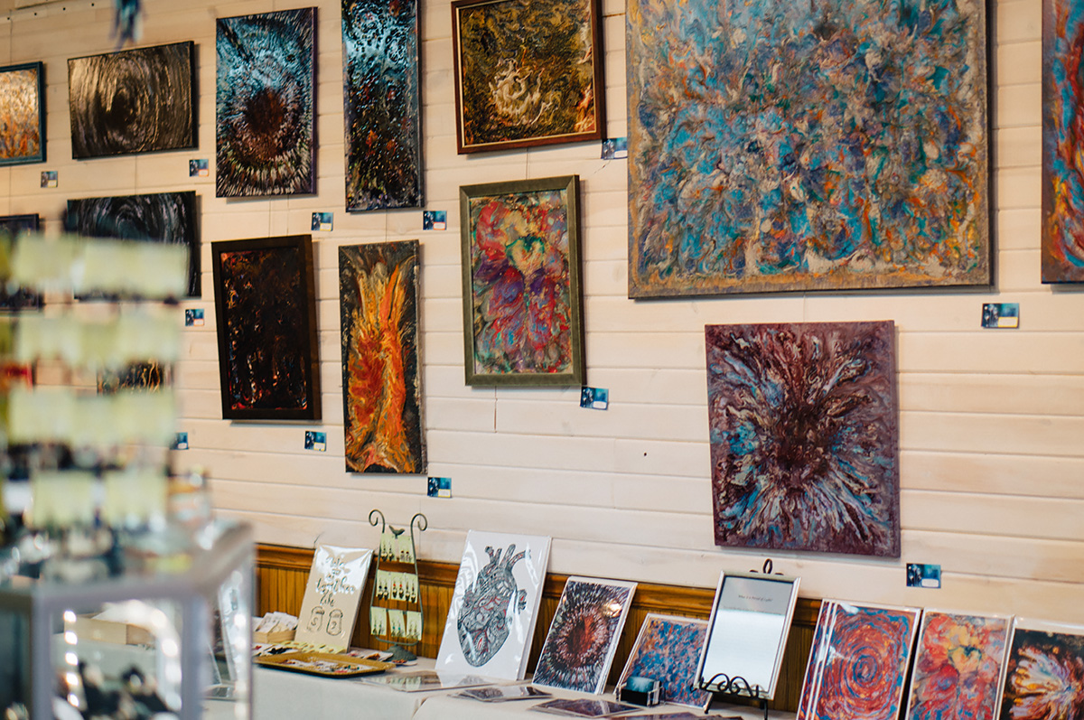 "Local artist Tanya Meyer's collection titled ""Portal of Lights"" is on display at Tangled Up In Hue on South Barstow Street in downtown Eau Claire. Each piece uses a variety of colors, patterns and textures to portray her artwork."