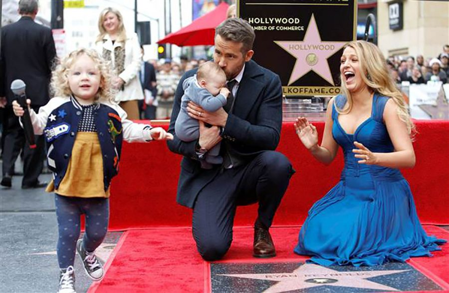 Ryan Reynolds and Blake Lively debut their children for the first time at Reynold's Hollywood Walk Of Fame ceremony in December of 2016.