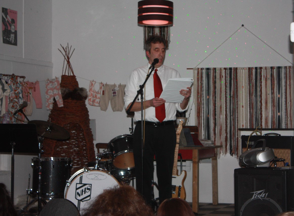Ken Szymanski, one of three performers at the event, read stories exploring and reflecting on different types of love.