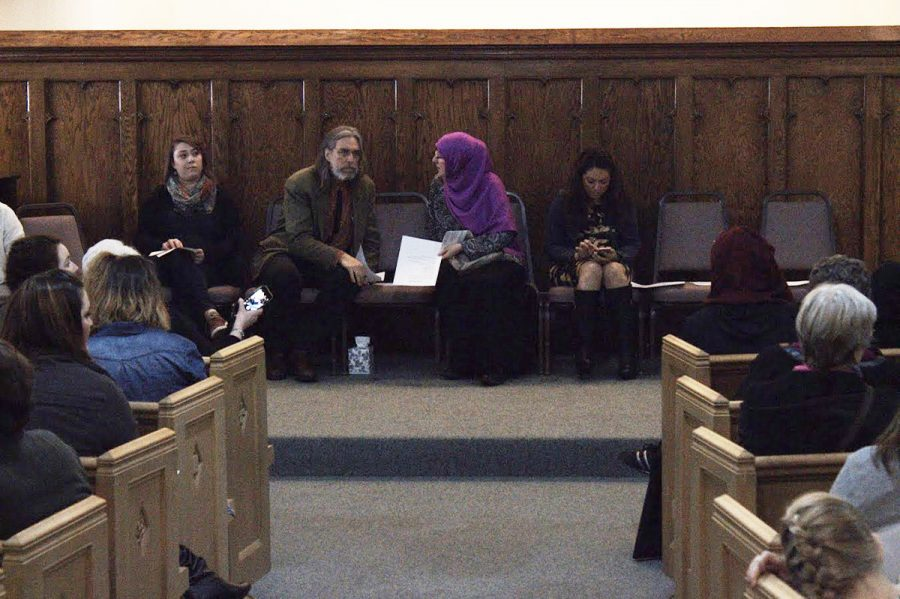 Speakers sit toward the front of the Unitarian Universalist Congregation Wednesday night. Around a dozen speakers addressed issues concerning President Trump's recent executive order barring immigrants from seven countries.
