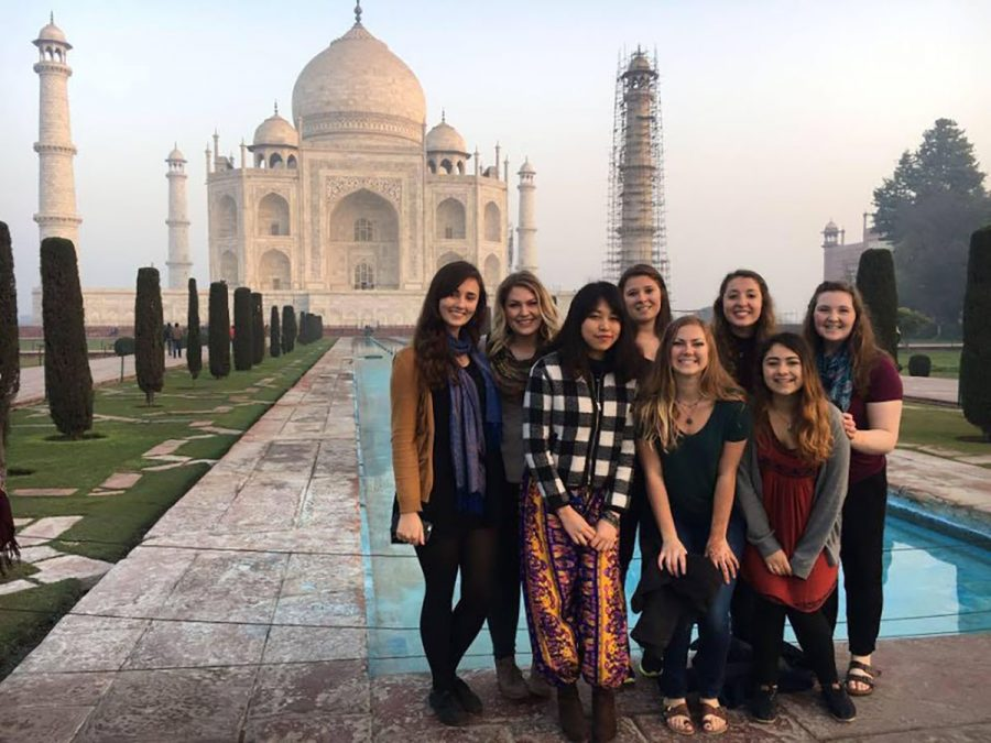 Course+members+stand+in+front+of+the+Taj+Mahal.+The+Blugold+women%E2%80%99s+studies+students+were+studying+in+India+over+winterim+for+just+shy+of+three+weeks.+After+listening+to+lectures%2C+participating+in+discussion+and+working+in+fieldwork+projects%2C+the+students+presented+their+findings+to+one+another.