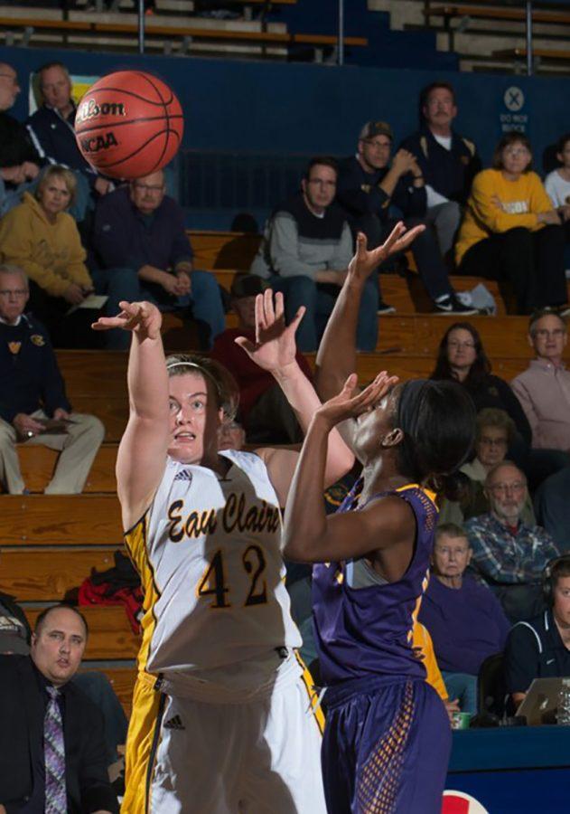 Junior forward Kayla Hanley attempts a shot over her defender.