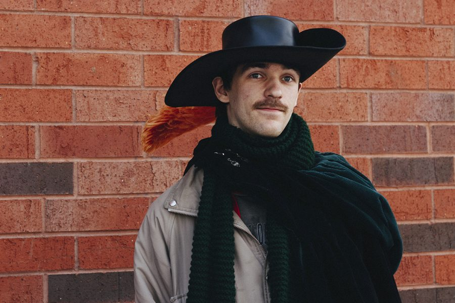 Luke Jarocki shows off renaissance garb; his cape and scarf made by his sister and hat a gift from his mother.