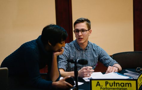Student Body President Ashley Sukhu and Parliamentarian Alec Putnam engaged in conversation; both were supporters of the update to Student Senate's campaign policy.
