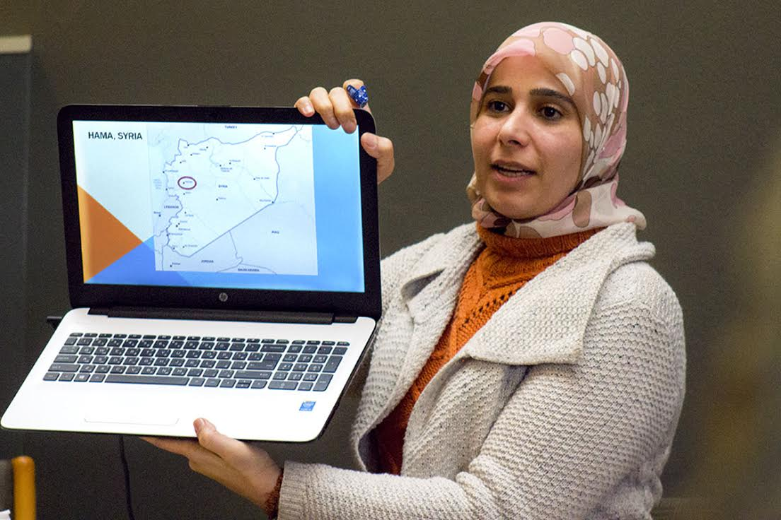 Ghada Ghazal talks about her personal experiences in Syria and her path to becoming an interfaith speaker with Eau Claire community members Thursday at the Ecumenical Religious Center.