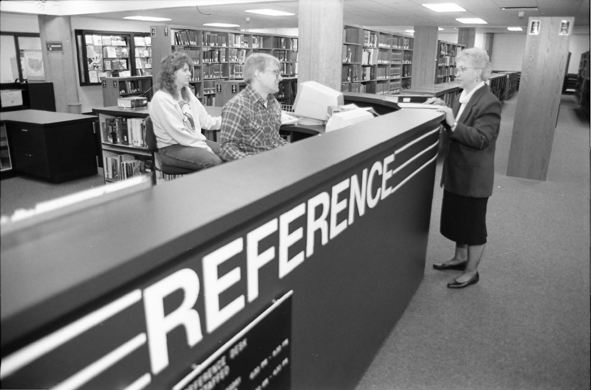 Pictured above in McIntyre Library's front Reference desk in February of 1994.