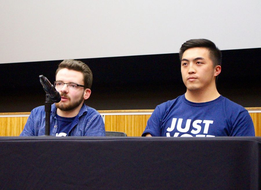 (From left) Nathan Altmann and Justin Vue share their platform with attendees at the presidential debate Wednesday, April 5.