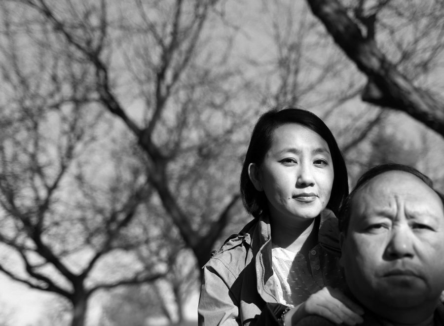 """Yang was joined by her father, the subject of """"A Song Poet,"""" for a public reading of her book. He sang a piece of song poetry for the audience before she read from her book."""