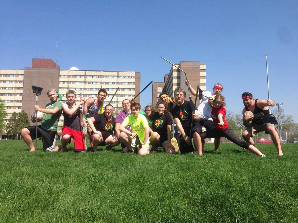 The Eau Claire Student Ministry of Magic poses for a photo after playing Quidditch. While the club has its basis in Harry Potter, the aim of the executive members is inclusivity and acceptance for all.
