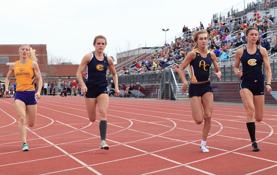 Claire Fischer (left) and Kelsey Worachek (right) compete in the 100-meter dash at the Ashton May Invitational on Saturday.