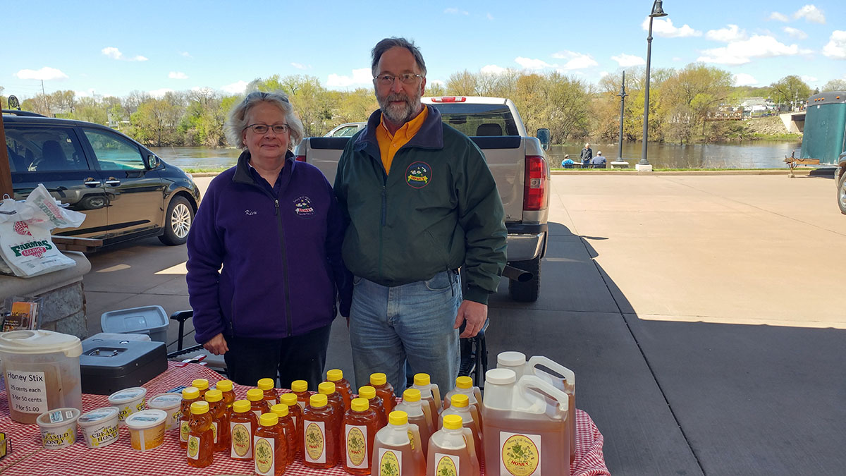 Kim (left) & Doug (right) Sjostrom stand at their booth for the first farmers market of the year.