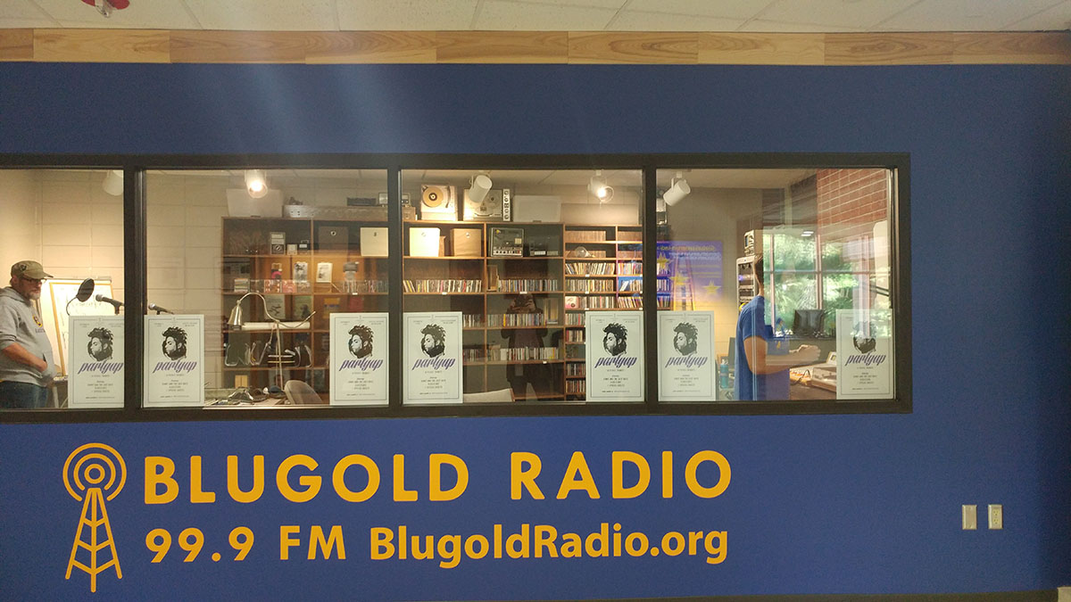 Scott+Morfitt+and+Eli+Klatt+coordinate+the+Blugold+Radio+99.9+broadcast+in+their+new+home+in+McIntyre+Library.