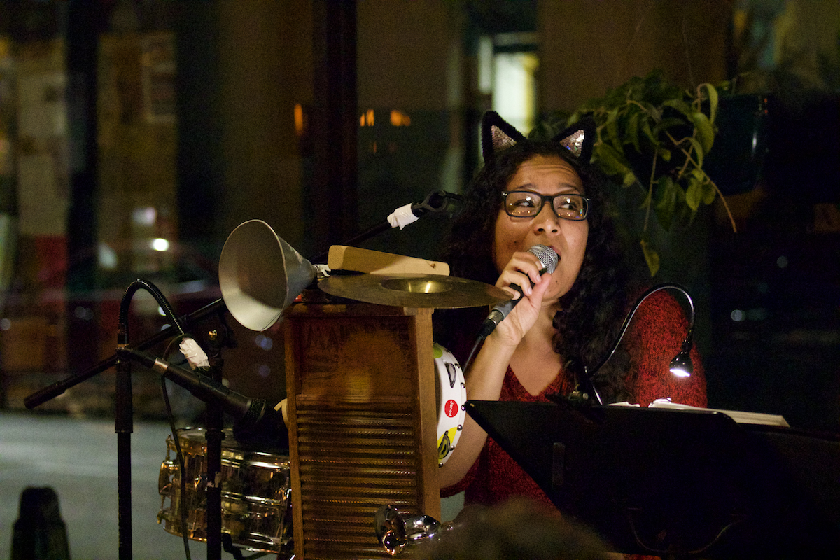 """Kitty Norton of """"Jack and Kitty"""" sings and plays the whizzbang, a washboard-like instrument. The duo covered originals and covers, ranging from """"Three Little Birds"""" to """"Sweet Dreams (Are Made of This)."""""""