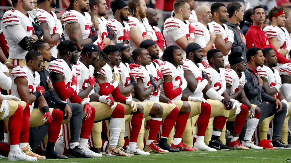 NFL players kneel as they continue to protest against racial inequality and police brutality.