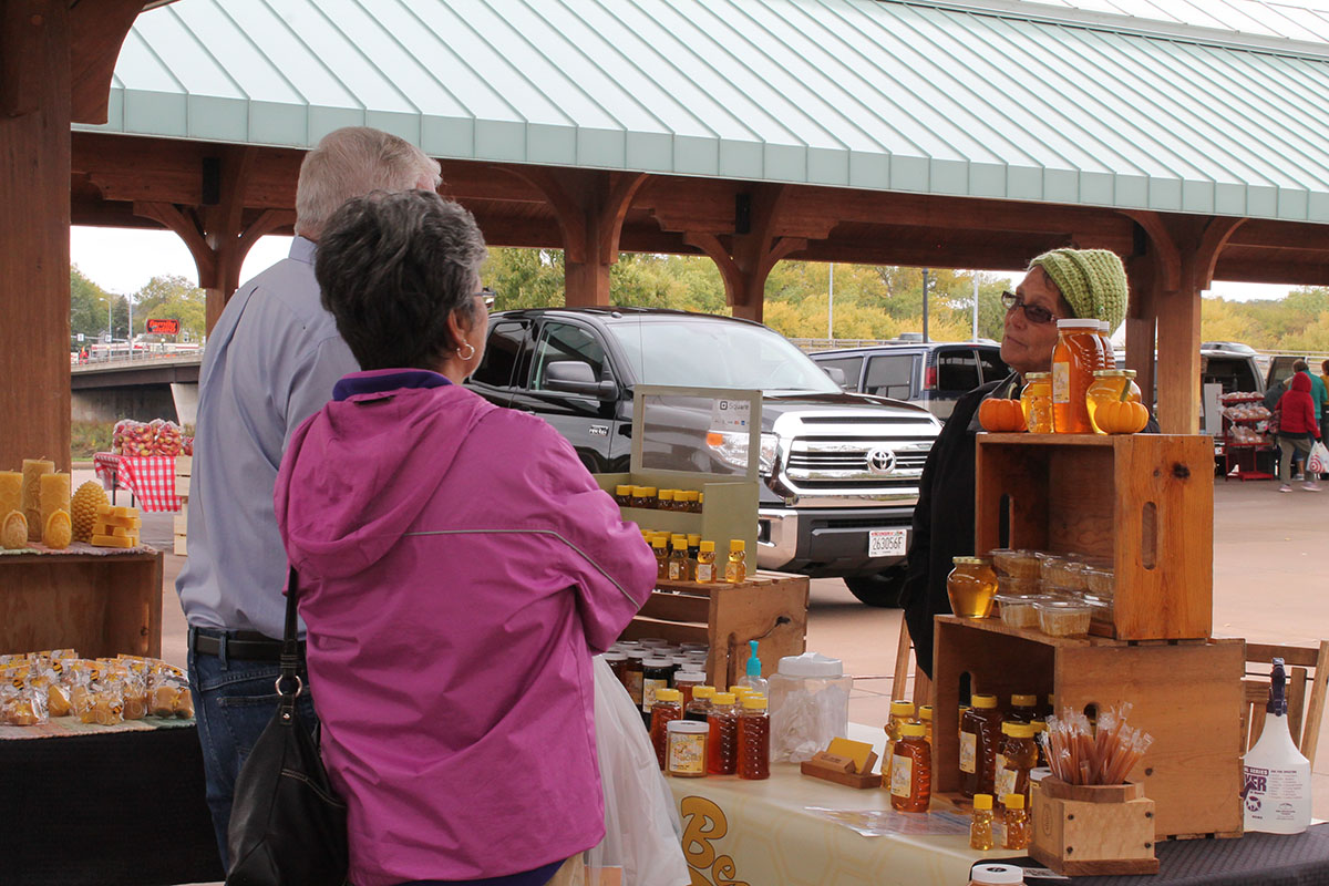 Eau Claire community members gather in Phoenix Park to buy local produce and goods from a multitude of vendors.