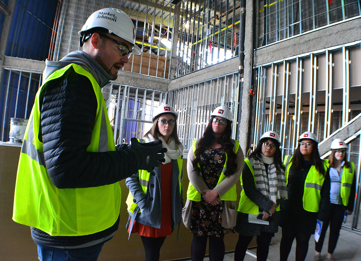 Student senators walk through the Confluence Arts Center on a tour guided by Jason Jon Anderson, the executive director of the project. The building is set to open in Fall 2018.