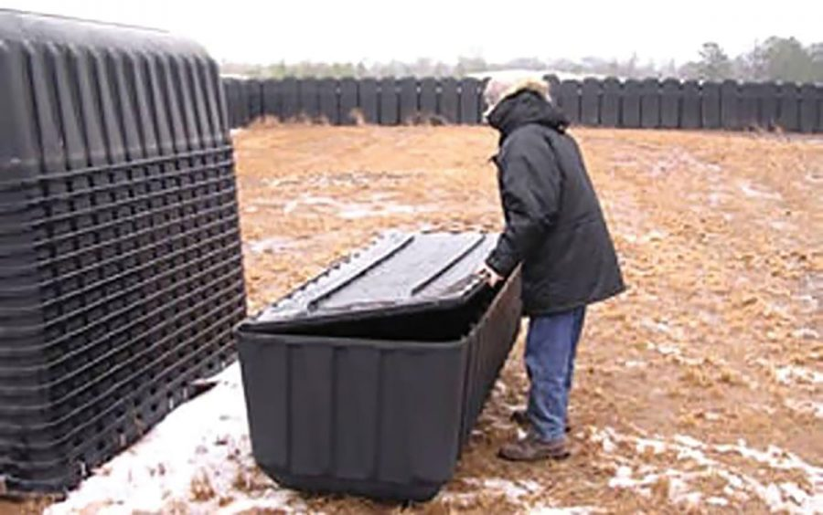 Stacks of plastic coffins line an open field off the highway in Madison, GA and conspiracy theorists say this is part of the government's  preparation for a revolt.