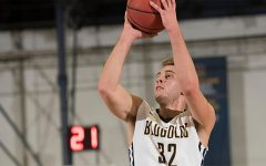 Men's basketball drops first two road contests
