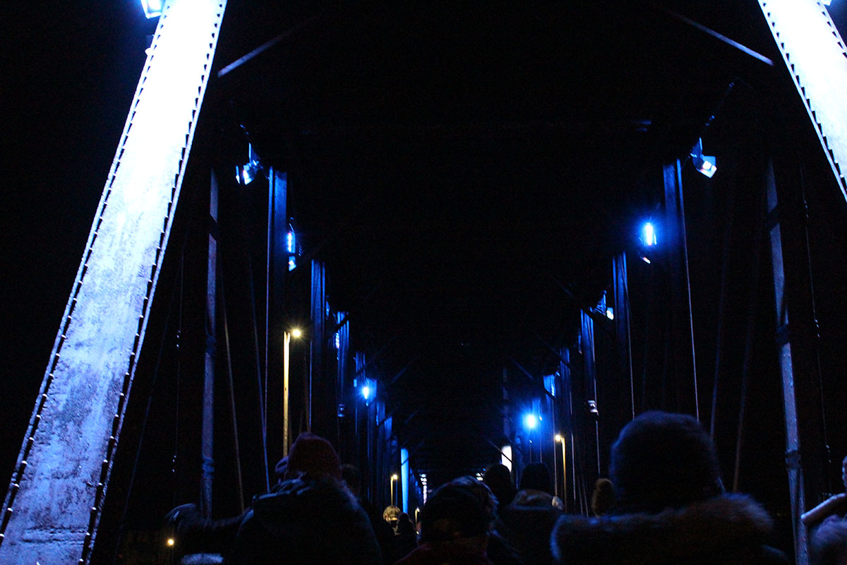 The Phoenix Park footbridge lit up as people made their way to the Clearwater Winter Parade.
