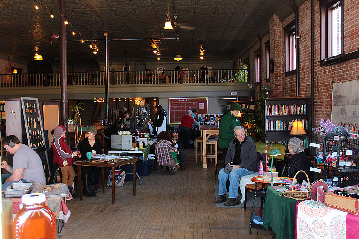 Shoppers peruse the Menomonie winter market at Raw Deal.