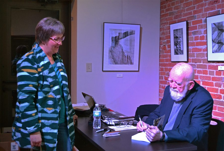 Former UW-Eau Claire professor Wil Denson signed books this past Friday night at Volume One.
