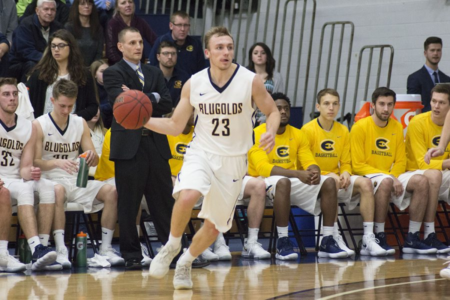 Ben Widdes looks for an opening in the paint. The team's persistent intensity won them last Saturday's game against UW-Stevens Point.