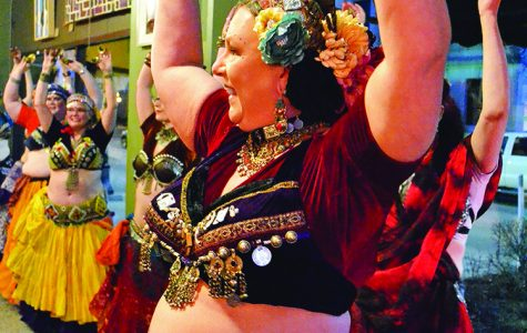 People gathered Saturday night to watch belly dance performances by Lasa Anahata Tribal and Geek Slink Belly Dance.