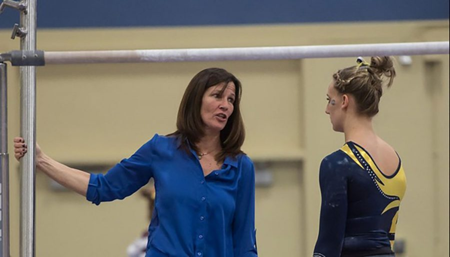 """The gymnasts are who have inspired me. As much as I have given them, they have given back to me ten-fold,""  DeLisle said"