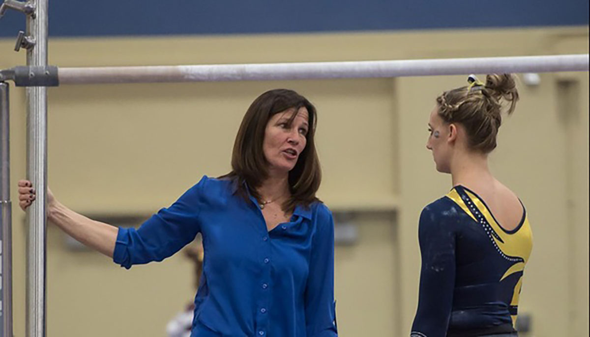 """""""The gymnasts are who have inspired me. As much as I have given them, they have given back to me ten-fold,""""  DeLisle said"""