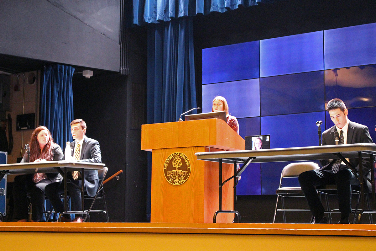 From left to right: Candidates Maddie Forrest (vice president)  and Branden Yates (president), and Hattie Salzman (vice president, tuning in via video chat) and Robert Nguyen (president) participate in the Student Body President Debate on Wednesday.