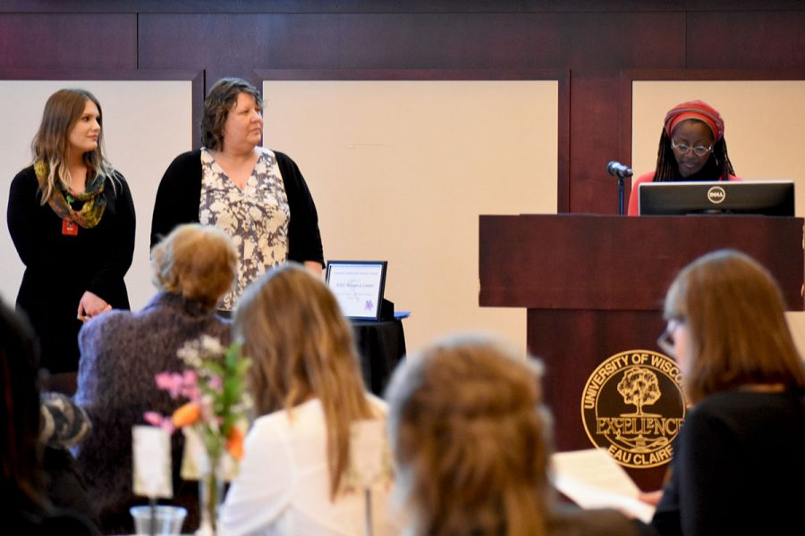 Program director Rose-Marie Avin presented the Feminist Community Mentor Award to two UW-Eau Claire alums, Cheryl Thiede (right) and Nicole Sornson (left).