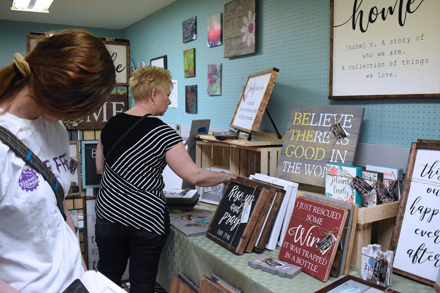 At the art market, visitors can stop by 15 or 16 booths and purchase arts and crafts.